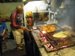 Soccer player tending the Braai at Mossel Bay